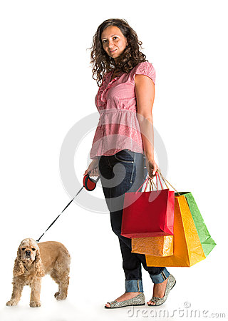 Curly woman with shopping bags and american spaniel