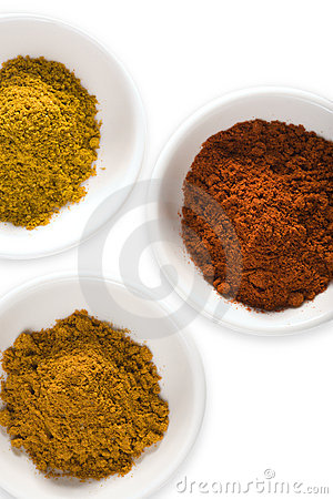 Curry powder, turmeric and cayenne isolated