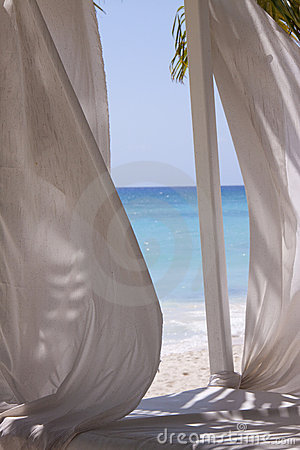 Curtains on tropical beach