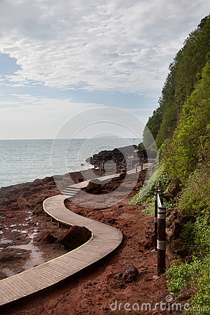 Curve wooden walkway by the sea