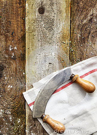 Curved double handled knife