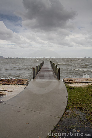 Curved Path to Pier Stormy Afternoon - Vertical