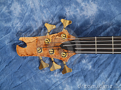 Curved patterned wood bass guitar headstock