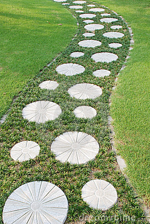 Curving stepping stone path in the garden