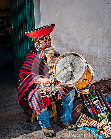 Free CUSCO, PERU - OCTOBER 1, 2016: Native Peruvian Playing National Musical Instrument Zampona Marimacha, Dressed In Colorful Tradit Royalty Free Stock Photos - 85021078