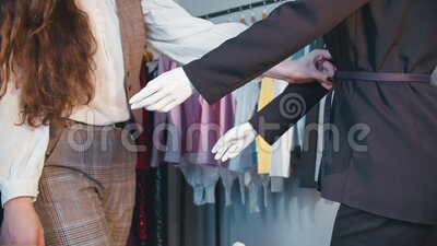 Custom clothing fashion look designer outfit. Custom clothing. Fashion look. Female designer trying outfit accessory on mannequin stock video footage