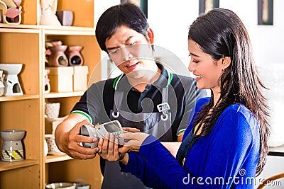 Customer in an Asian Pottery shop