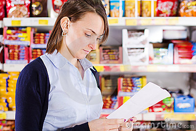 Customer looking at shopping list