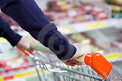 Customer pushing shopping cart