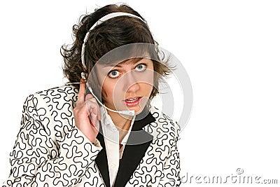 Customer service tech listens over her headset