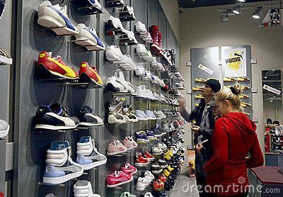 Customers shopping in mall - Puma store interior Editorial Photography