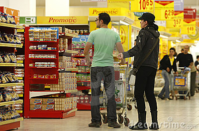 Customers shopping at supermarket Editorial Stock Photo
