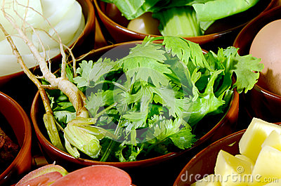 Cut coriander leaves and roots.