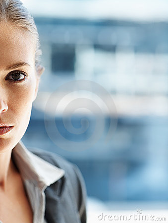 Cut image of a pretty business woman, serious look