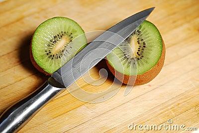 Cut by a kiwi on chopping board