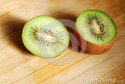 Cut by a kiwi on chopping board