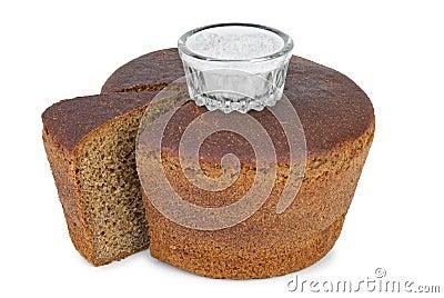 Cut loaf of round rye bread