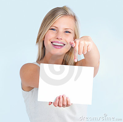 Cut out of  girl pointing down at billboard