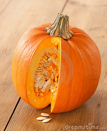 Cut Pumpkin Exposing Seeds