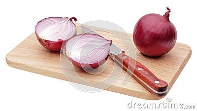 Cut red onion bulb on board
