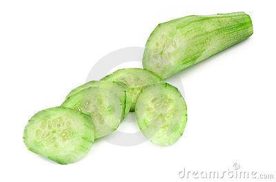 Cut ripe cucumber on white