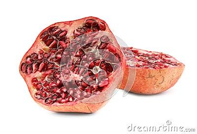 Cut ripe pomegranate fruit on white