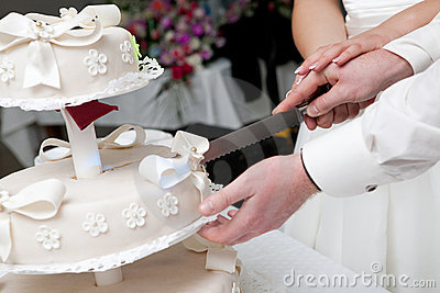 Cut of a slice of a wedding cake