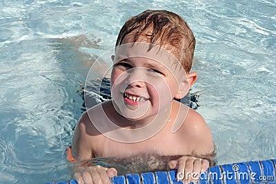 Cute 6-year-old boy in pool