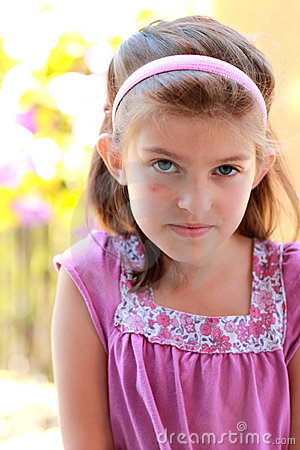 A cute 8 year old girl in pink