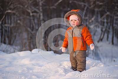 Cute adorable baby stay near mountain side