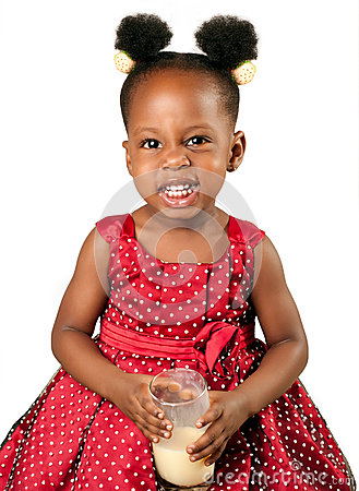 Cute african american girl drinking milk