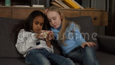 Cute african american girl playing with smartphone stock footage