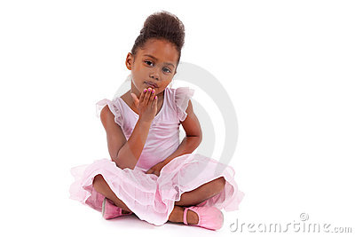 Cute African girl sitting on the floor