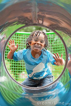 Cute african little boy at playground