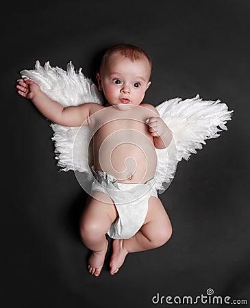 Cute angel baby boy