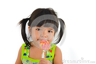 Cute asian baby girl and big lollipop