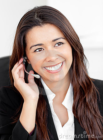 Cute asian businesswoman phoning with an earpiece
