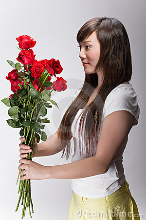 Cute asian girl accepting flowers