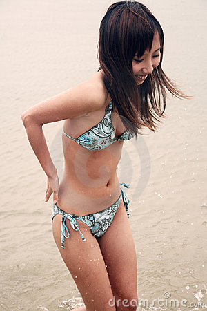 Cute Asian girl in a bikini