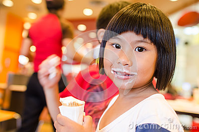 Cute Asian girl eating ice cream