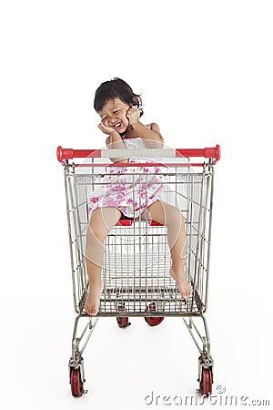 Cute Asian Girl Inside Shopping Trolley