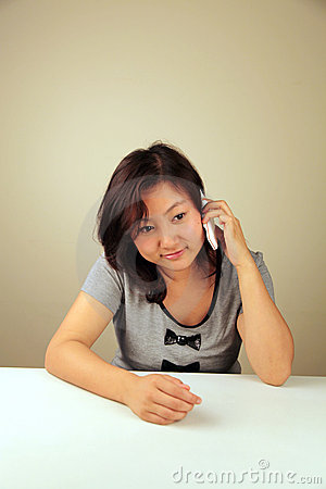 Cute Asian girl making a call