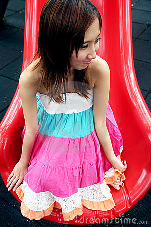 Cute Asian girl on a slide