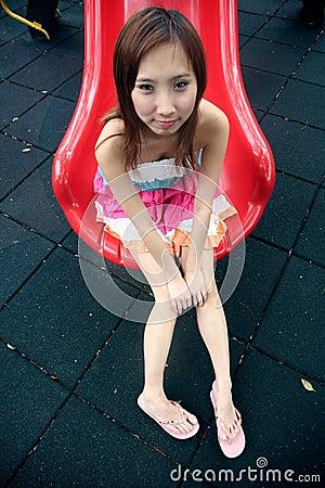 Cute Asian girl on a slide