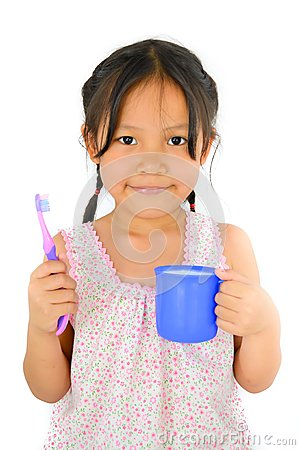 Cute asian girl and toothbrush