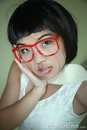 Cute Asian girl wearing glasses