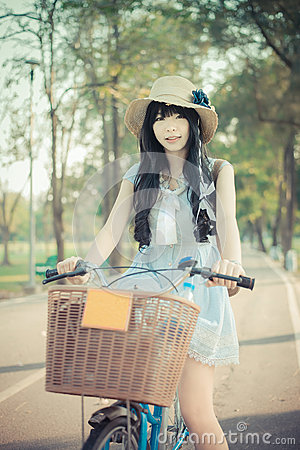 Free Cute Asian Thai Girl In Vintage Clothing Is Standing With Her Bi Royalty Free Stock Photos - 51696848