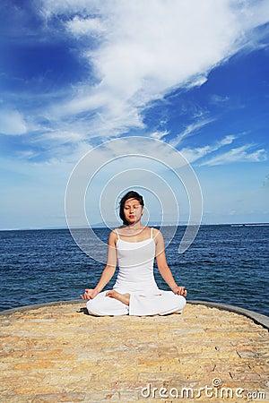 Cute Asian Woman Meditating
