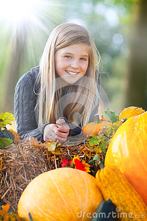 Cute autumn girl smiling