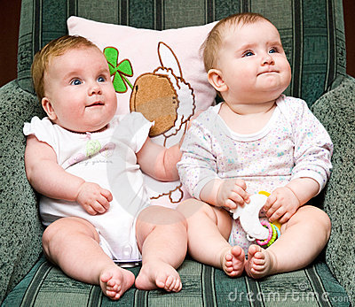 Cute babies on chair